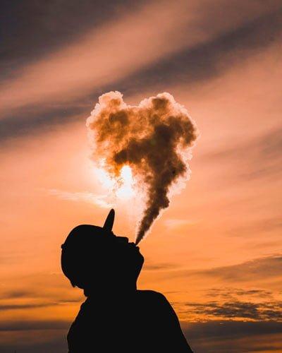 Man exhaling big CBD vape cloud